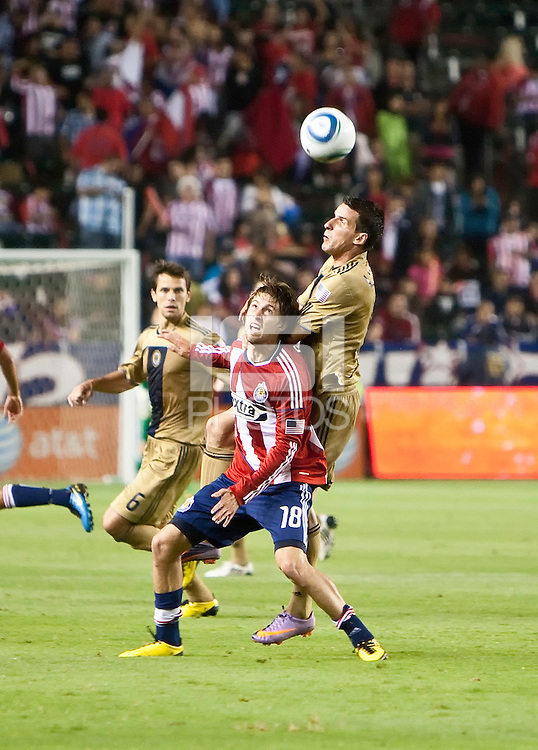 Philadelphia Union forward Sebastien Le Toux (9) jumps to head the ball over Chivas USA midfielder Blair Gavin (18) during the second half of the game between Chivas USA and the Philadelphia Union at the Home Depot Center in Carson, CA, on July 3, 2010. Chivas USA 1, Philadelphia Union 1.