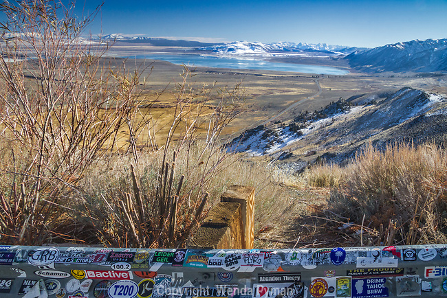 View of Mono Lake from Conway Summit/ Guard rail with stickers in the foreground.