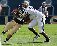 Pittsburgh full back Henry Hynoski is wrapped up by UConn defensive end Jesse Joseph. Pittsburgh Panthers defeat the University of Connecticut Huskies 24-21 on October 10, 2009 at Heinz Field, Pittsburgh, PA.