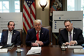 United States President Donald J. Trump speaks between US Secretary of State Mike Pompeo (R) and US Secretary of Health and Human Services Alex Azar during a Cabinet Meeting at the White House in Washington, DC on October 21, 2019.<br /> Credit: Yuri Gripas / Pool via CNP