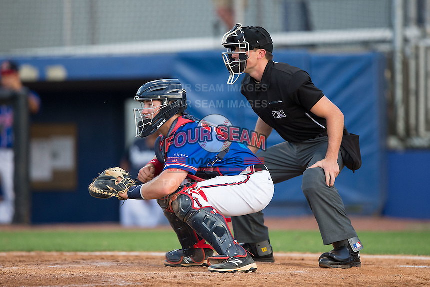 Danville Braves catcher Brett Cumberland (26) sets a target as home plate umpire Matthew Brown looks on during the game against the Kingsport Mets at American Legion Post 325 Field on July 9, 2016 in Danville, Virginia.  The Mets defeated the Braves 10-8.  (Brian Westerholt/Four Seam Images)