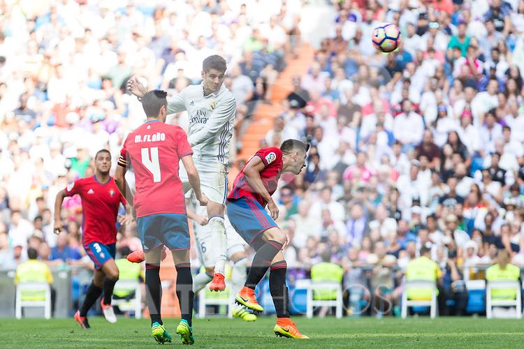 Real Madrid's Alvaro Morata and Club Atletico Osasuna's Unai Garcia and Miguel Flano during the match of La Liga between Real Madrid and Club Atletico Osasuna at Santiago Bernabeu Estadium in Madrid. September 10, 2016. (ALTERPHOTOS/Rodrigo Jimenez)