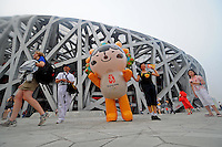 Aug. 8, 2008; Beijing, CHINA; Fans pose with the official mascot prior to the opening ceremonies for the 2008 Beijing Olympic Games at the National Stadium. Mandatory Credit: Mark J. Rebilas-