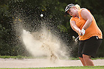Duramed Futures Tours' Amanda Mathis from Opelousas, LA punches the ball out of the bunker on the 11th hole during Alliance Bank Golf Classic in Syracuse, NY.