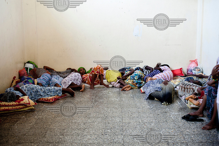 Women sleeping on the floor at the Central Prison in Hodeidah where 58 women and 7 children are held. One inmate said: 'In Yemen, being a woman is like being an animal.' Another said says: 'Let's not talk about human rights.  Let's talk about animal rights because that's what we are.'