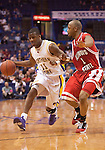 March 08 2009   Kwadzo Ahelegbe (11, left) of Northern Iowa is followed by Emmanuel Holloway of Illinois State in the first half.  The Panthers of the University of Northern Iowa defeated the Redbirds of Illinois State University 60-57 in overtime in the championship game of the Missouri Valley Conference Tournament on Sunday March 8, 2009 at the Scottrade Center in downtown St. Louis, Missouri.   ..         *******EDITORIAL USE ONLY*******