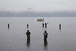 Puget Sound, Hood Canal, salmon fishermen fishing for Chum salmon, rain, winter, Hoodsport, Hoodsport Salmon Hatchery, Olympic Peninsula, Washington State, Pacific Northwest, USA,