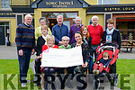 Christy Lehane from Kerry Friends of Motor Neurone presenting the cheque for €38709.86 to Marie Reavey and Aisling Farrell from IMNDA in the Torc Hotel, Lissivigeen last Wednesday. Pictured with l-r Tom Mac Donnell, Mary Lehane, Betty Carmody, Pat Kelleher, Paddy Keeffe, Frances Kelleher, Denis Russell, Ethan Kelleher and Nora Murphy.