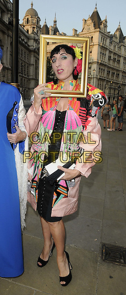 Rossy de Palma.The NSPCC Pop Art Ball, Banqqueting House, Whitehall, London, England..May 24th, 2012.full length white pink green print jacket black dress picture frame funny.CAP/CAN.©Can Nguyen/Capital Pictures.