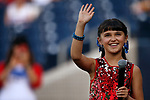 Brooklyn Remington sings the National Anthem before the Sacramento River Cats game against the Reno Aces game, in Reno, Nev., on Thursday, July 4, 2019.<br /> Photo by Cathleen Allison/Nevada Momentum