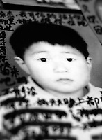 "Chen Zhijie, 5 years and 3 months, who was stolen, his mother believes by a neighborhood gang. Message read ""My poor son where are you? I miss you very much. Are you okay now? Please come back. Mum can't live without you. Mum dreams of you every night, dreaming that have come back to our sides. Don't know when can our dream comes true.""..PHOTO BY SINOPIX"