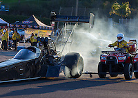 Feb 8, 2015; Pomona, CA, USA; NHRA top fuel driver Shawn Langdon is pushed off the track by a member of the safety safari on a quad after winning the Winternationals at Auto Club Raceway at Pomona. Mandatory Credit: Mark J. Rebilas-