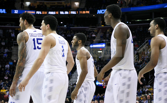 The Kentucky players are all smiles after a touch shot made by Andrew Harrison during second half of the Sweet 16 of the 2015 NCAA Men's Basketball Tournament against the  at Quicken Loans Arena on Thursday, March 26, 2015 in Cleveland , Ky. Photo by Jonathan Krueger | Staff.