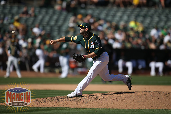 OAKLAND, CA - SEPTEMBER 8:  Cory Gearrin #61 of the Oakland Athletics pitches against the Texas Rangers during the game at the Oakland Coliseum on Saturday, September 8, 2018 in Oakland, California. (Photo by Brad Mangin)