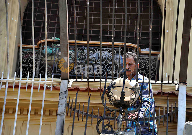 An Egyptian man carries things looted from the headquarters of the Muslim Brotherhood, in the al-Moqattam suburban, Cairo, Egypt, 01 July 2013. Medics said at least 12 people were killed in the fighting that started 30 June around the Muslim Brotherhood's biggest offices, in the suburban Cairo area of al-Moqattam. Protesters torched the first floor of the building on 01 July. Activists said Muslim Brotherhood members inside the building responded with live fire and shotgun rounds. Photo by Ahmed Asad