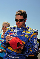 Apr 25, 2009; Talladega, AL, USA; NASCAR Sprint Cup Series driver Elliott Sadler signs autographs during qualifying for the Aarons 499 at Talladega Superspeedway. Mandatory Credit: Mark J. Rebilas-