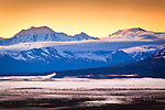 Sunrise at Alaska Range, view from Denali Hway. Fog blankets the valley. Southcentral Alaska, Summer.