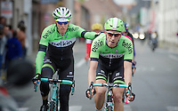 Sep Vanmarcke (BEL/Belkin) is escorted back into the peloton by teammate Jos van Emden (NLD/Belkin) while being provided with fresh bidons from the teamcar along the way<br /> <br /> Ronde van Vlaanderen 2014