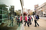 Students walk to and from the Georgia State University Student Center in downtown Atlanta, Georgia April 2, 2009. The school, which is located in the middle of downtown Atlanta, just started a football program, although it does not even have a football field. KENDRICK BRINSON