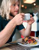 USA, California, Los Angeles, man having breakfast at BLD restaurant.