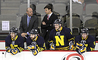 Former UNO player Mike Gabinet (right), is an assistant coach for Northern Alberta Institute of Technology. Nebraska-Omaha beat the NAIT Ooks 6-1 at the CenturyLink Center in Omaha on Monday, October 7, 2013. (Photo by Michelle Bishop)