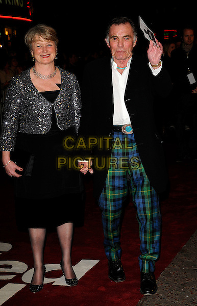 "GUEST & MAURICE ROEVES.World Premiere of ""The Damned United"" at the Vue West End, Leicester Square, London, England..March 18th 2009.full length black dress jacket green blue plaid tartan trousers hand waving holding hands silver jewel encrusted jacket .CAP/CAN.©Can Nguyen/Capital Pictures."