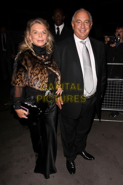 TINA GREEN & SIR PHILIP GREEN.The Vogue Dinner Party at La Caprice Restaurant, London, England..September 21st, 2009.full length black suit leopard print brown dress clutch bag married husband wife phillip.CAP/AH.©Adam Houghton/Capital Pictures.