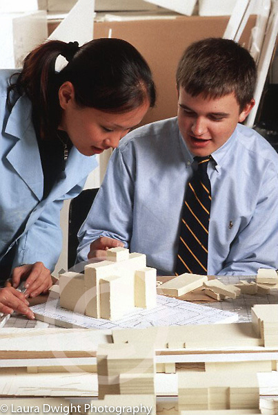 Internship program for college students at major architectural firm, young man supervised by female staff member
