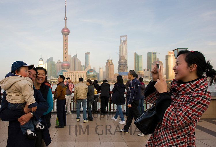 Tourists at the Bund to view the Pudong Financial District skyline, Shanghai, China