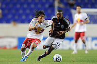 Irving Garcia (99) of the New York Red Bulls is cahsed by Ross LaBauex (16) of the Colorado Rapids. The New York Red Bulls defeated the Colorado Rapids 3-0 during a U. S. Open qualifier match at Red Bull Arena in Harrison, NJ, on May 26, 2010.