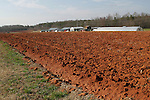 Tobacco farmer John Ashe farms nearly 90 acres of tobacco fields in Reidsville, NC, some of those acres shown here on Friday, Feb. 24, 2012, near a greenhouse, back right, where Ashe recently planted nearly 1,500 trays of tobacco seeds.  North Carolina tobacco farmers fear they could lose much of their export business because the health industry wants to exclude tobacco products from a major trade agreement with eight Pacific Rim countries.   Photo by Ted Richardson