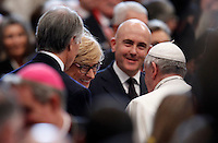 Papa Francesco saluta il Ministro della Difesa Roberta Pinotti ed il presidente del CONI Giovanni Malago', a sinistra, al termine della messa per gli sportivi in occasione del 100esimo anniversario del CONI, nella Basilica di San Pietro, Citta' del Vaticano, 19 dicembre 2014.<br /> Pope Francis greets Italian Defense Minister Roberta Pinotti, center, and the Italian Olympic Committee (CONI)   president Giovanni Malago', left, at the end of a mass for the CONI's 100th anniversary in St. Peter's Basilica at the Vatican, 19 December 2014.<br /> UPDATE IMAGES PRESS/Isabella Bonotto<br /> <br /> STRICTLY ONLY FOR EDITORIAL USE