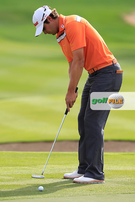 Peter Uihlein (USA) takes his putt on the 13th green during Sunday's Final Round of the Abu Dhabi HSBC Golf Championship 2015 held at the Abu Dhabi Golf Course, United Arab Emirates. 18th January 2015.<br /> Picture: Eoin Clarke www.golffile.ie