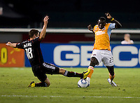 Devon McTavish (18) of DC United goes in for a tackle on Dominic Oduro (23) of the Houston Dynamo during their game at RFK Stadium in Washington, DC.  Houston defeated D.C. United, 3-1.