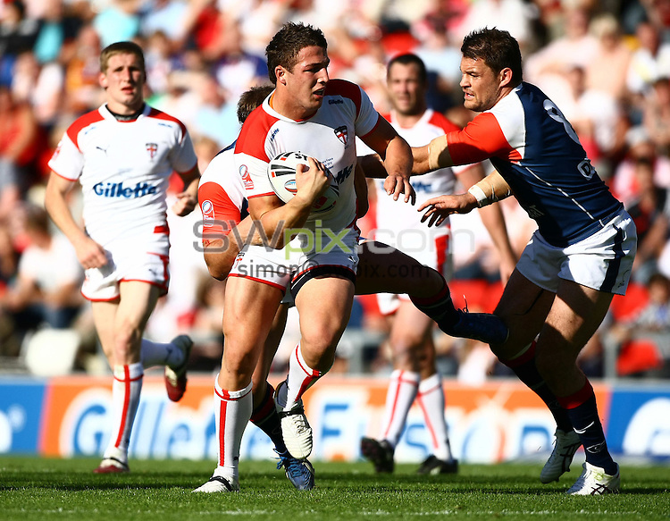 PICTURE BY VAUGHN RIDLEY/SWPIX.COM - Rugby League - International - England v France - Leigh Sports Village, Leigh, England - 12/06/10...Copyright - Simon Wilkinson - 07811267706...England's Sam Burgess gets past France's David Ferriol.