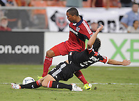 D.C. United defender Dejan Jakovic (5) goes against Chicago FIre defender forward Sherjill MacDonald (7) D.C. United defeated The Chicago Fire 4-2 at RFK Stadium, Wednesday August 22, 2012.