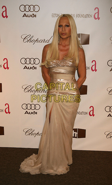 DONATELLA VERSACE.The 14th Annual Elton John AIDS Foundation Oscar Party, Co-hosted by Audi, Chopard and VH1 - Red Carpet, held at the Pacific Design Center, Hollywood, California, USA..Photo: Russ Elliot/Admedia/Capital Pictures .Ref: RE/ADM.full length cream dress .www.capitalpictures.com.sales@capitalpictures.com.© Capital Pictures.