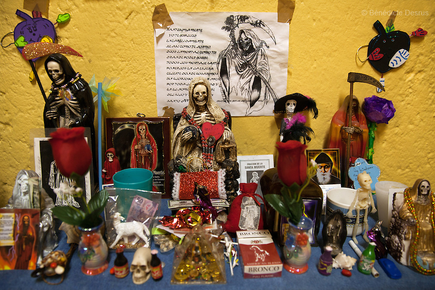 An altar of candles and offerings for the Santa Muerte (Saint Death) seen in the bedroom of Patricia, a resident of Casa Xochiquetzal, at the shelter in Mexico City, Mexico on July 8, 2013. Casa Xochiquetzal is a shelter for elderly sex workers in Mexico City. It gives the women refuge, food, health services, a space to learn about their human rights and courses to help them rediscover their self-confidence and deal with traumatic aspects of their lives. Casa Xochiquetzal provides a space to age with dignity for a group of vulnerable women who are often invisible to society at large. It is the only such shelter existing in Latin America. Photo by Bénédicte Desrus