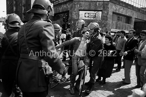 "Santiago, Chile.September 15, 1988..Chilean police arrest a man by pulling him off his bicycle when he shouted anti-General Augusto Pinochet slogans in support of the ""no"" vote for the plebiscite. ..In 1988, General Augusto Pinochet ordered a plebiscite vote asking Chilean citizens whether he should continue in office. It produced a decisive ""no"" vote and the following year he lost the first presidential election in 19 years. However, under a constitution crafted by his advisors, he remained as army commander until 1998. Pinochet continued to wield enormous power until his arrest in London on human rights charges in October 1998."
