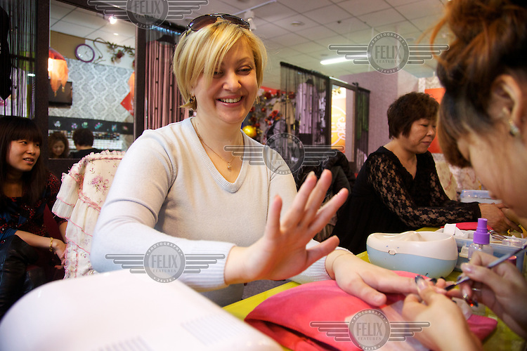 Viktoria, 39, from Khabarovsk, travelled 1200 km to the border Chinese town of Heihe to enjoy manicure and shopping.  Russians arrive in big groups to shop in the China across the Russian-Chinese border.