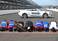 May 28, 2017; Indianapolis, IN, USA; IndyCar Series driver Takuma Sato and crew kiss the bricks as he celebrates after winning the 101st Running of the Indianapolis 500 at Indianapolis Motor Speedway. Mandatory Credit: Mark J. Rebilas-USA TODAY Sports