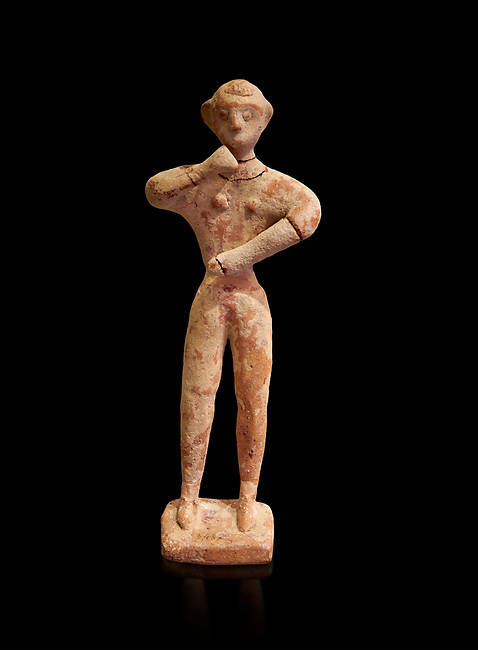 Minoan clay male figurine in the attitude of worship, Chamezi 1900-1700 BC; Heraklion Archaeological  Museum, black background.