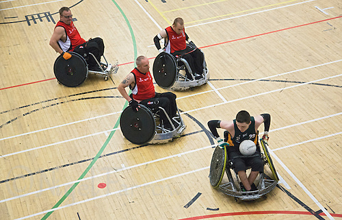 27 MAY 2013 - DONCASTER, GBR - Thomas Moylan (bottom right) of the Gaelic Warriors races to the goal line in the 2013 Great Britain Wheelchair Rugby Nationals match against the Solent Sharks at The Dome in Doncaster, South Yorkshire .(PHOTO (C) 2013 NIGEL FARROW)