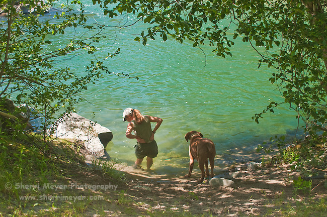 Woman and her dog enjoying the North Fork of the American River, Weimar, California.