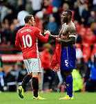 Wayne Rooney of Manchester United shakes hands with Wes Morgan of Leicester City during the Premier League match at Old Trafford Stadium, Manchester. Picture date: September 24th, 2016. Pic Sportimage