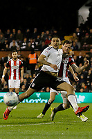 GOAL - Aleksandar Mitrovic of Fulham FC strikes on goal during the Sky Bet Championship match between Fulham and Sheff United at Craven Cottage, London, England on 6 March 2018. Photo by Carlton Myrie.