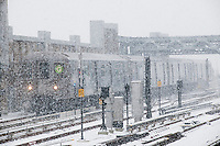 "A subway train at the Fourth Avenue station on the elevated portion of the IND line in the Gowanus neighborhood of Brooklyn in New York during a snow storm on Tuesday, January 21, 2014. The city is expected to receive between 8 and 14 inches of snow with brutal ""Polar Express"" temperatures in the single digits. The snow will taper off by Wednesday morning but the arctic temperatures are expected to last several days.  (© Richard B. Levine)"