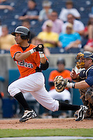 Melvin Dorta #3 of the Norfolk Tides follows through on his swing versus the Toledo Mudhens at Harbor Park June 7, 2009 in Norfolk, Virginia. (Photo by Brian Westerholt / Four Seam Images)