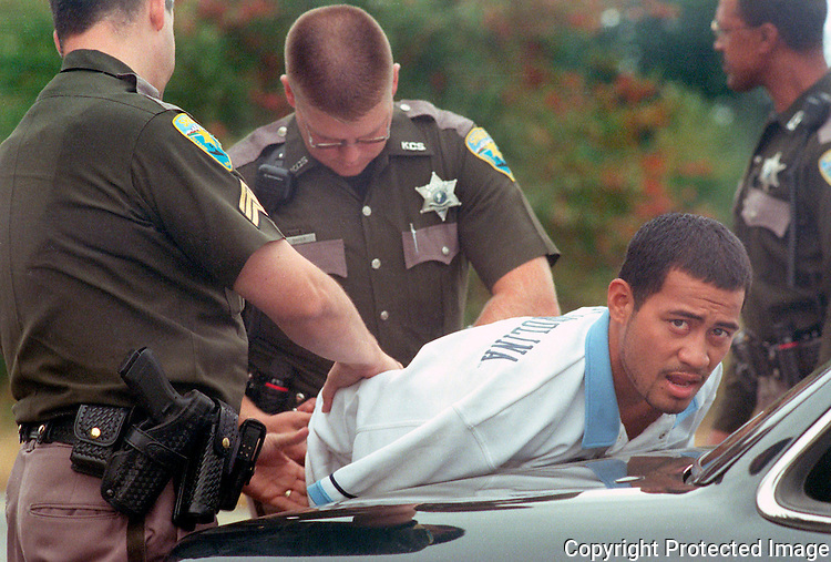 Kitsap County Sheriffs Deputies handcuff and take into custody a suspected bank robber. Jim Bryant Photo