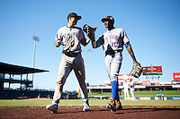 Scottsdale Scorpions Tyler Wade (41), of the New York Yankees organization, and Champ Stuart (10), of the New York Mets organization, walk to the dugout in between innings during a game against the Mesa Solar Sox on October 21, 2016 at Sloan Park in Mesa, Arizona.  Mesa defeated Scottsdale 4-3.  (Mike Janes/Four Seam Images)